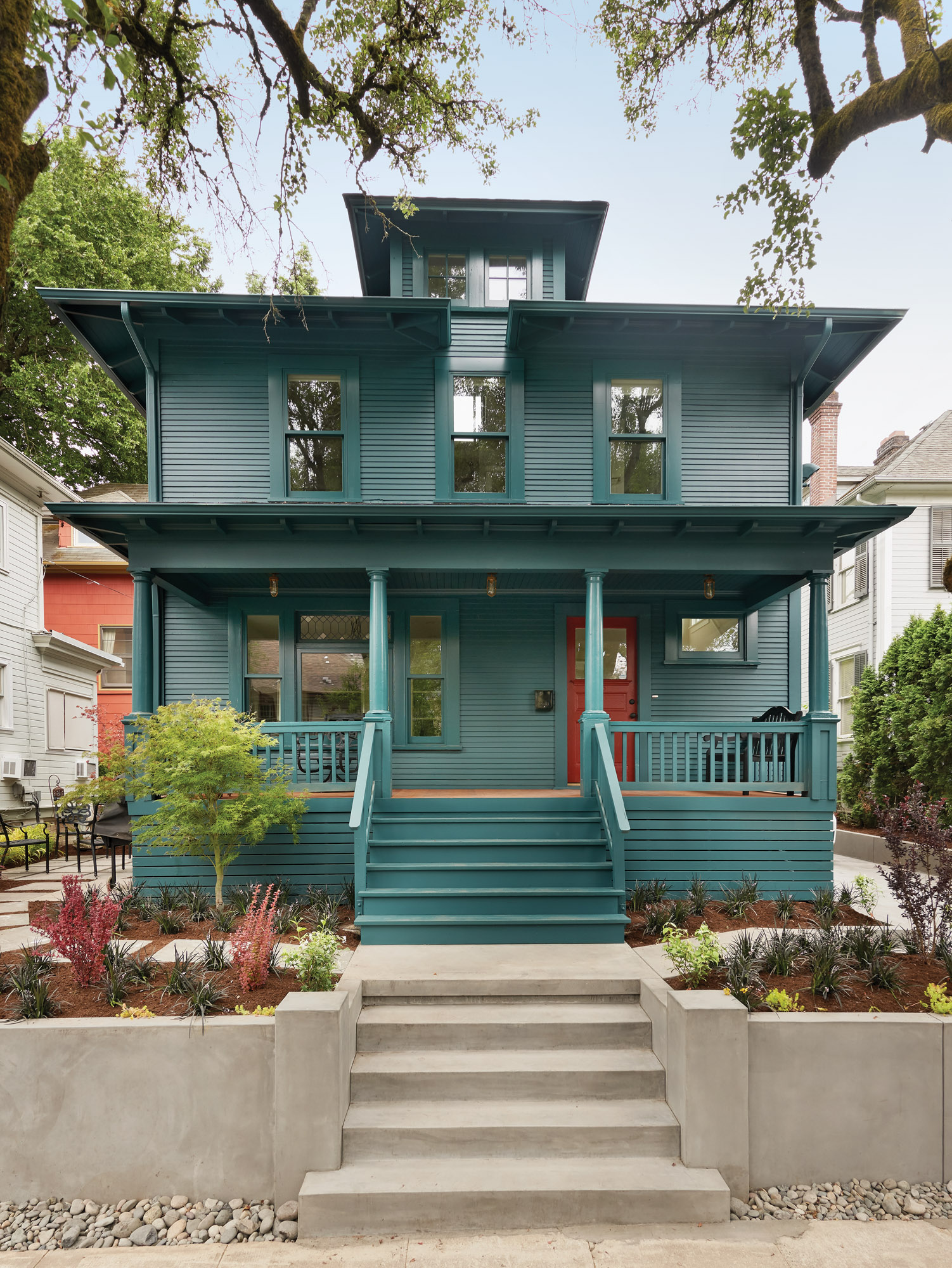 'Mallard Green' paint by Benjamin Moore (same hue, different sheen for body and trim) made the house the neighborhood jewel.