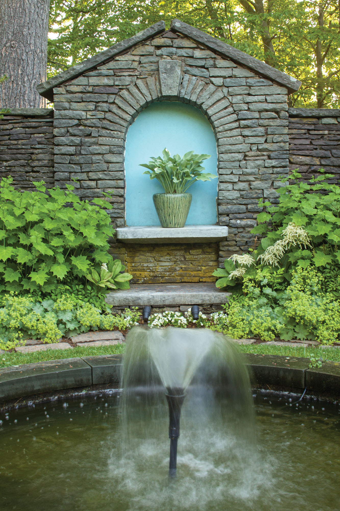 A fountain was added to the existing pool at one end of the sunken garden.