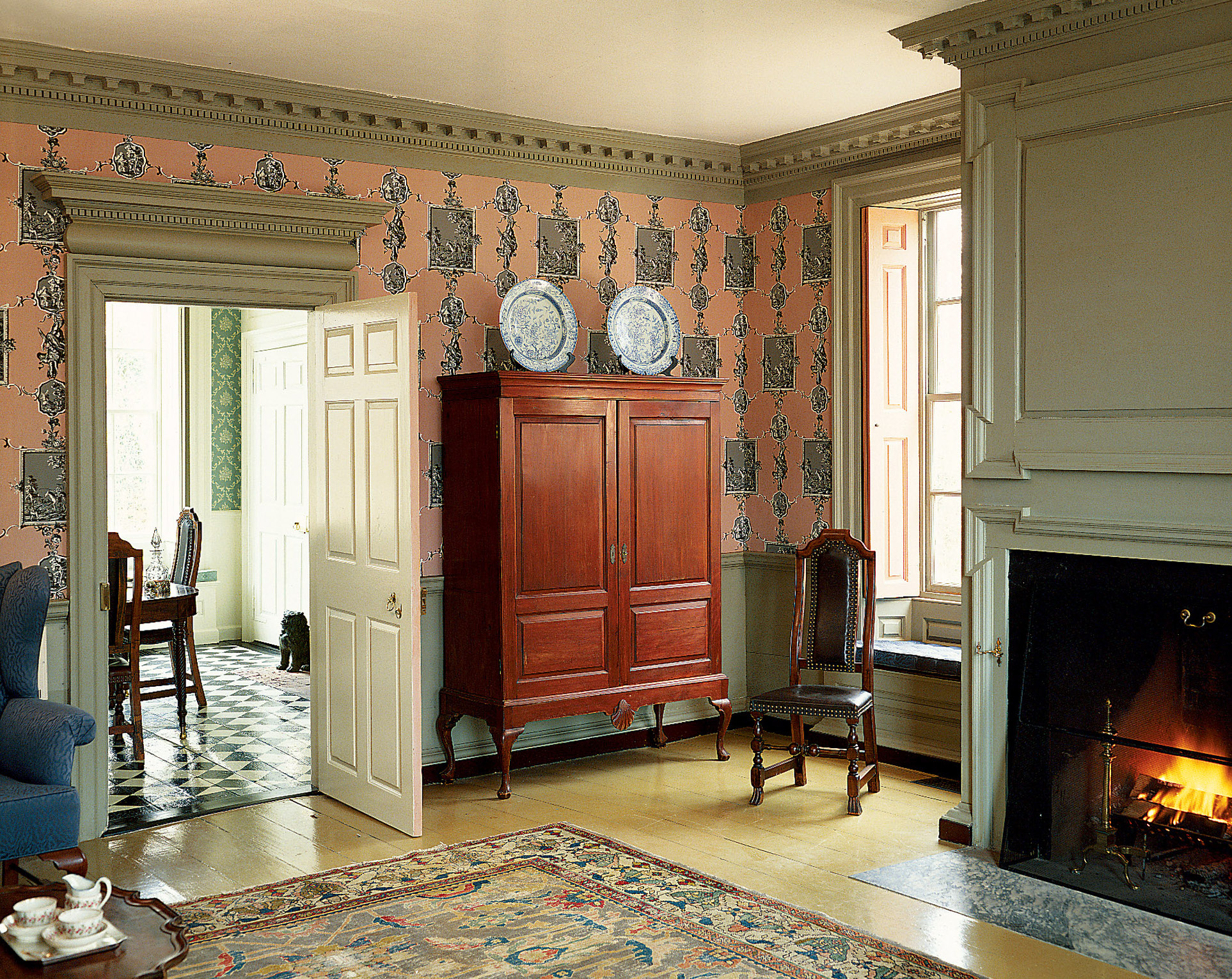 The elaborate Lady Pepperrell House (1760) at Kittery Point, Maine, was a favorite study piece for architects of the Colonial Revival. Colors and the English paper are authentic.