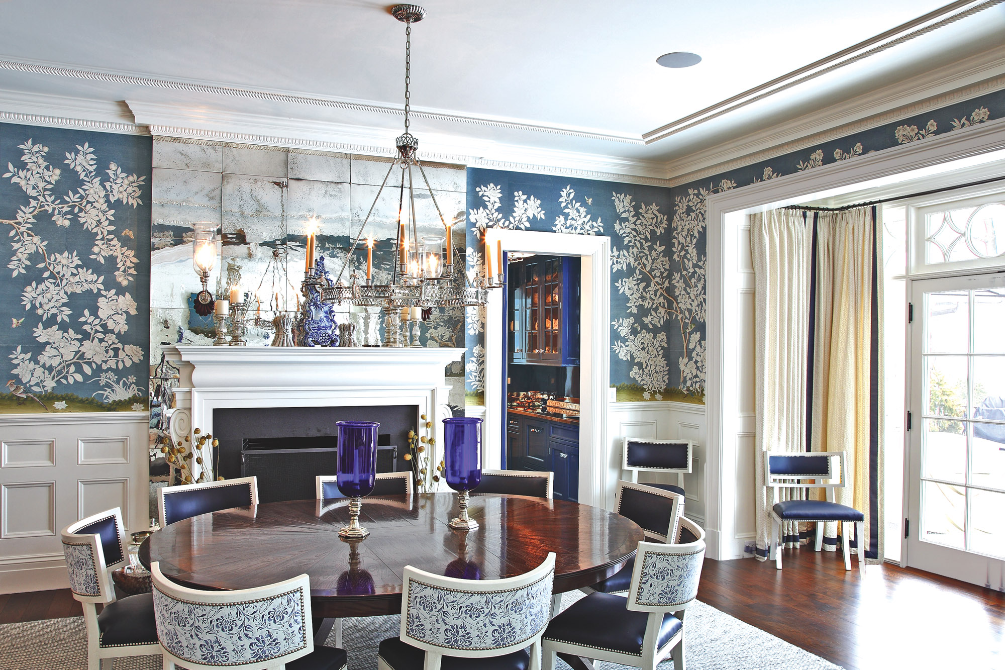 dining room with blue and white wallpaper