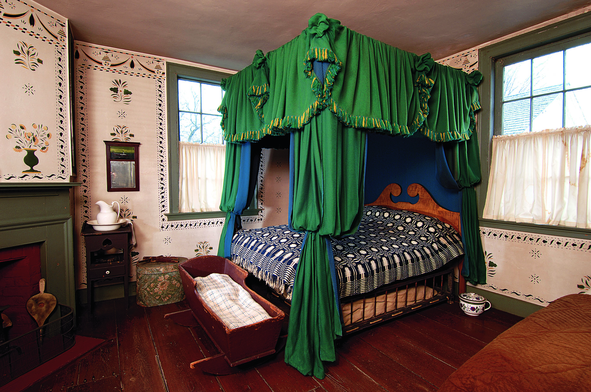 In a lavish bedroom of the early 1800s at the Farmers' Museum's Bump Tavern, wall stenciling was copied from the original.