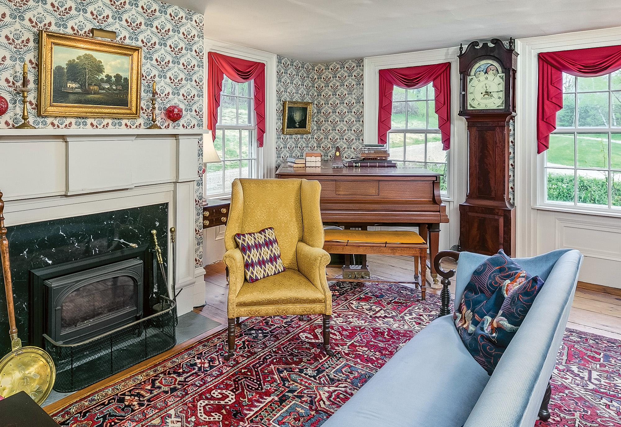 The double parlor includes a library behind pocket doors.