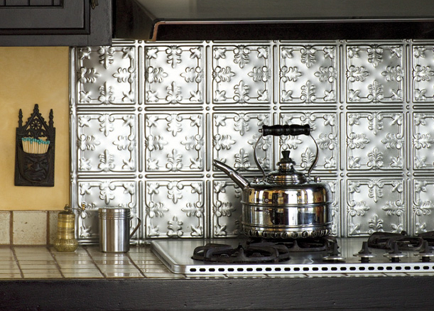 Varnished metal ceiling panels became the range backsplash in a Victorian house.