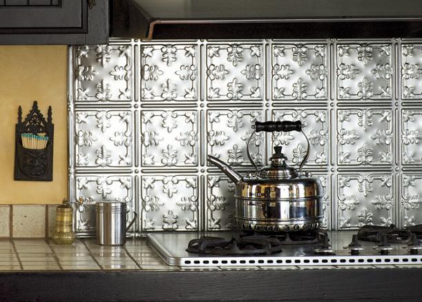 Varnished metal ceiling panels became the range backsplash in a Victorian house.