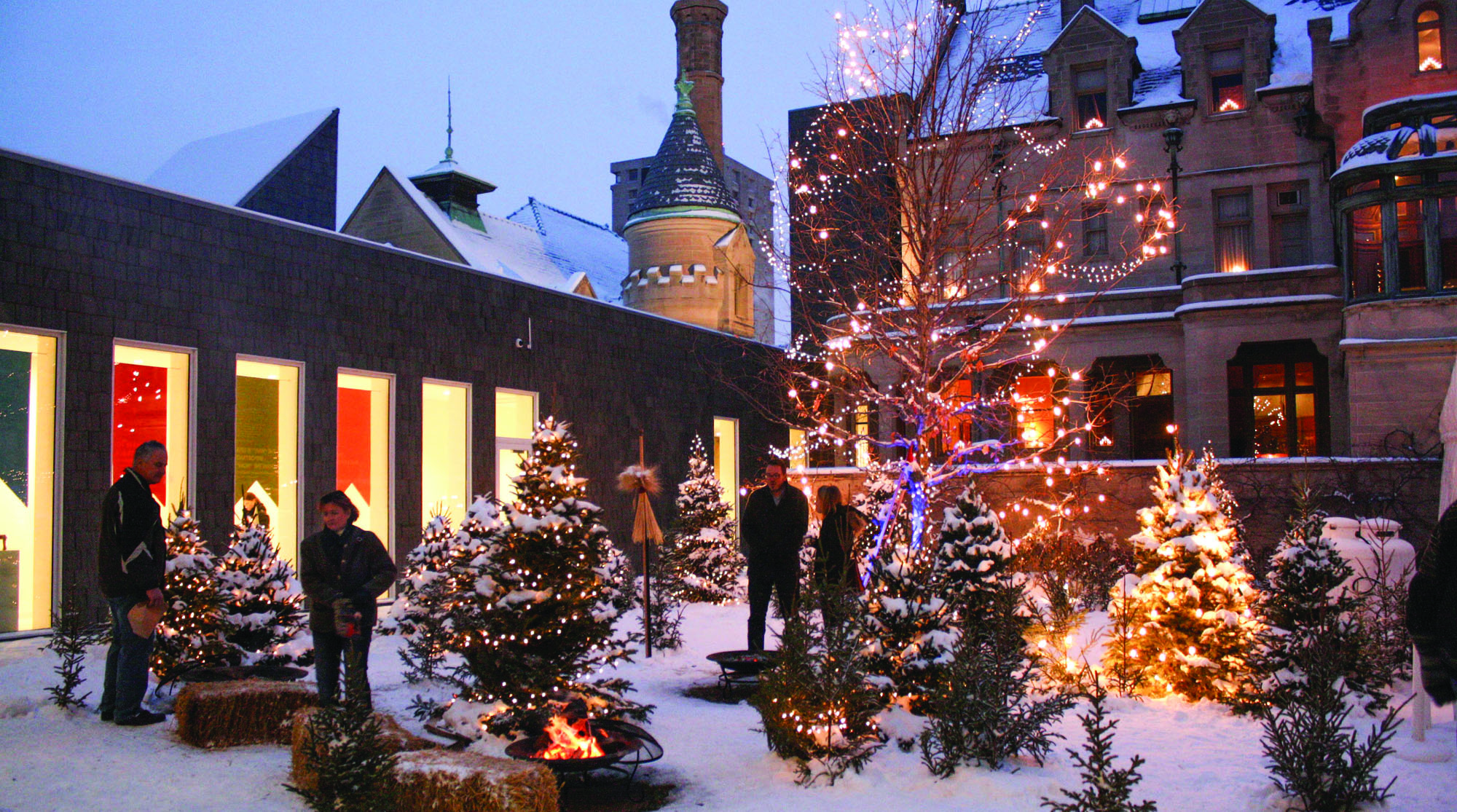 The courtyard at the Turnblad Mansion, lit with holiday lights during Julmarknad, a handcraft fair and holiday festival.