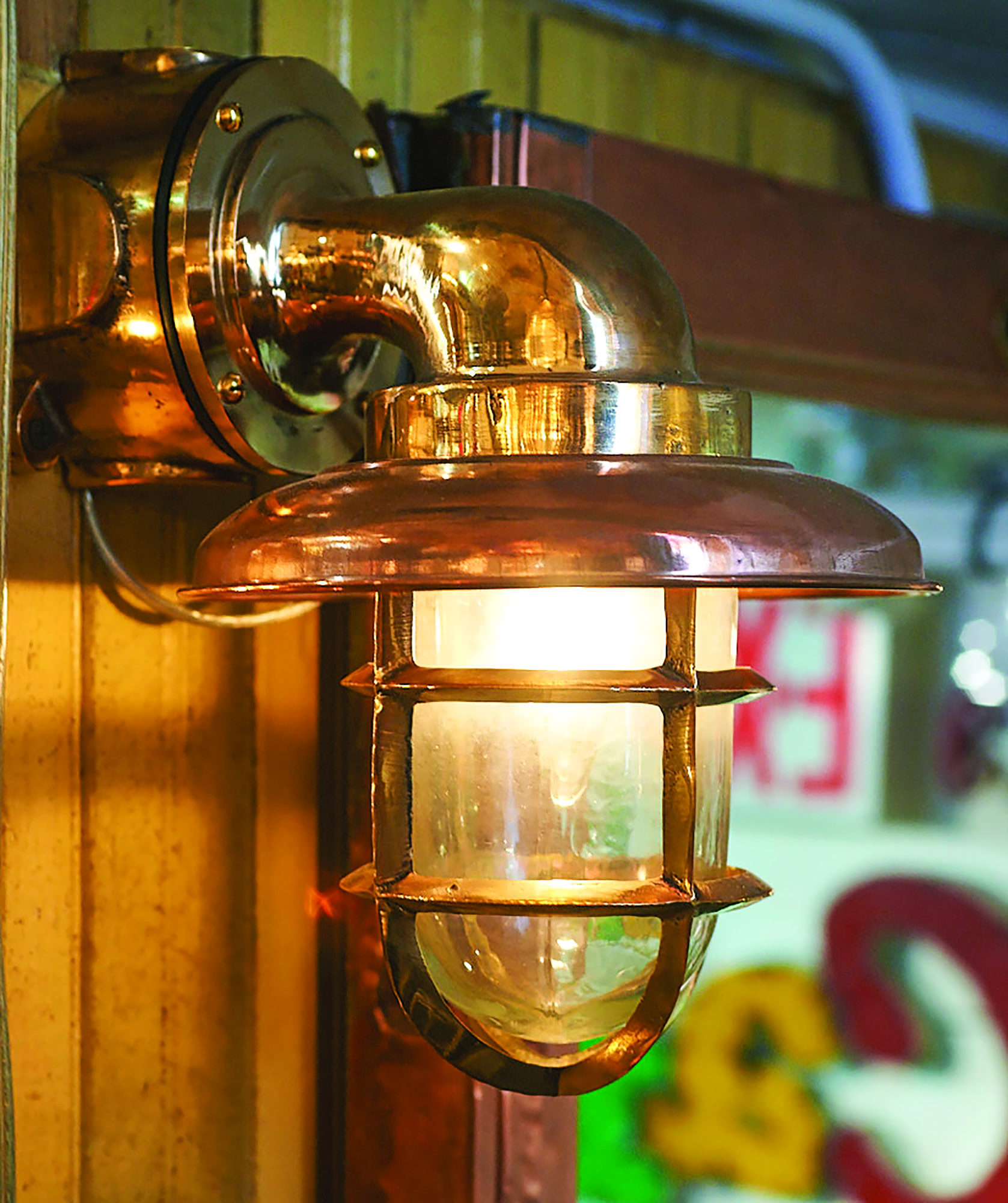 Old ship lights in brass and copper may be stripped and polished, or their patina left intact. They convert well to durable home lighting fixtures that come with an interesting history.