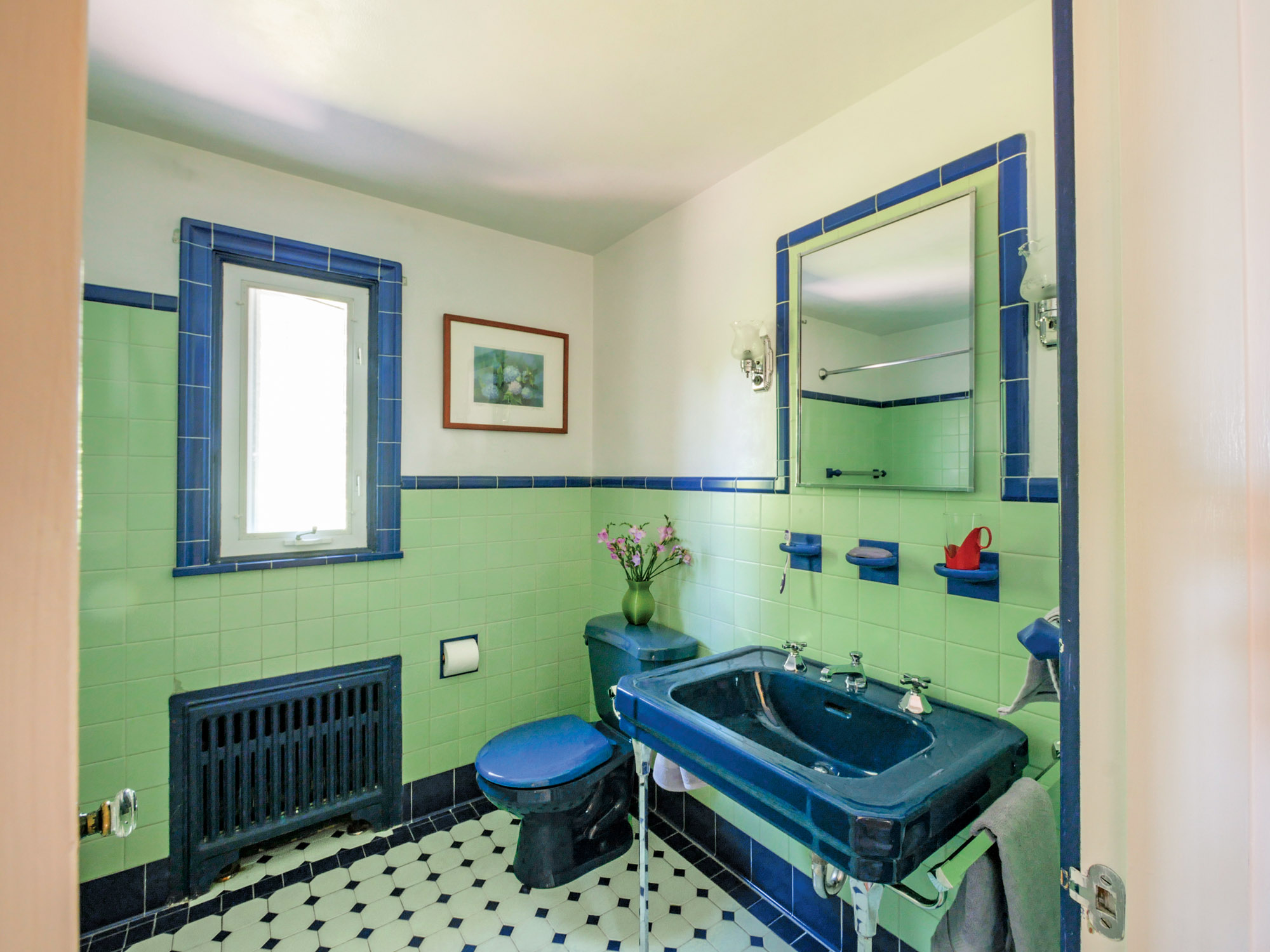 Only the toilets have been replaced in these surviving bathrooms. The rooms are bright, functional, and easy to maintain. Upstairs baths offer wide sinks and generous bathing areas.