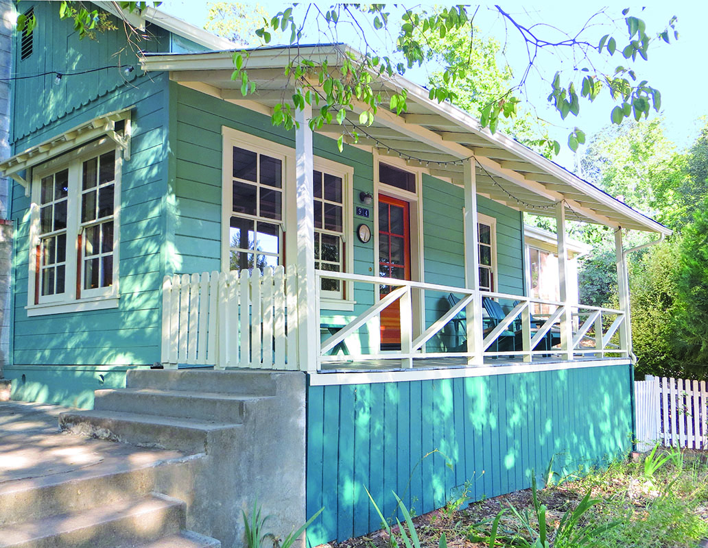 The quaint porch overlooks the town of Sonora, Cal. Double-glazed fir windows replaced aluminum versions from a previous remodeling. This owner's only addition has been a small, screened sleeping porch, accessible through French doors from the two bedrooms.