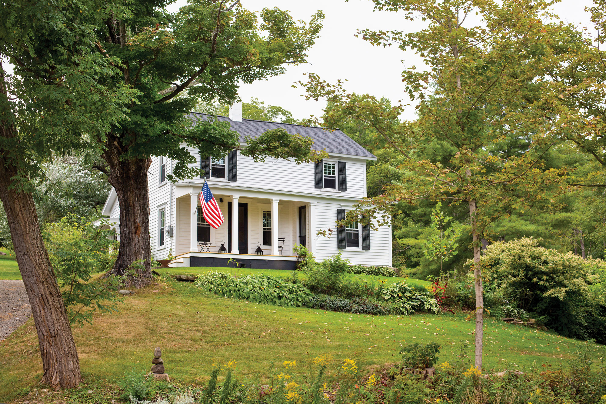The historic house had been neglected during a period of vacancy. Its Greek Revival porch has been restored, and the gardens revived in an agrarian landscape.