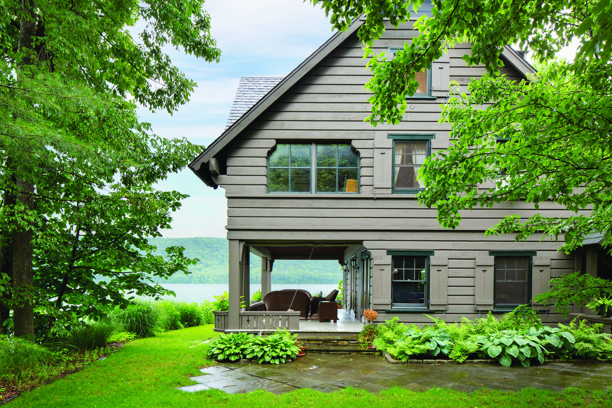The lakeside lodge is clad in  hemlock weatherboards. Cutouts and scalloped edges lend Swiss Chalet-style charm.
