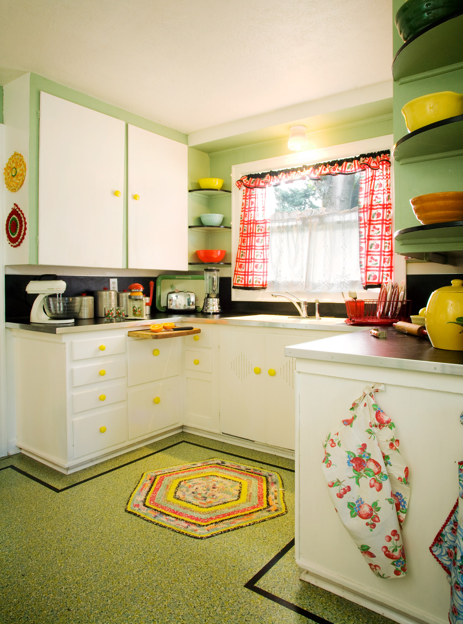 3. The near-original but worn kitchen was restored with Marmoleum flooring and countertops.