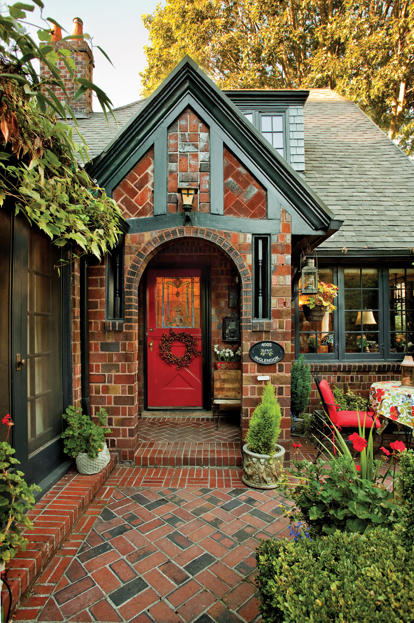 1920s Tudor home, red door, brick home with red door