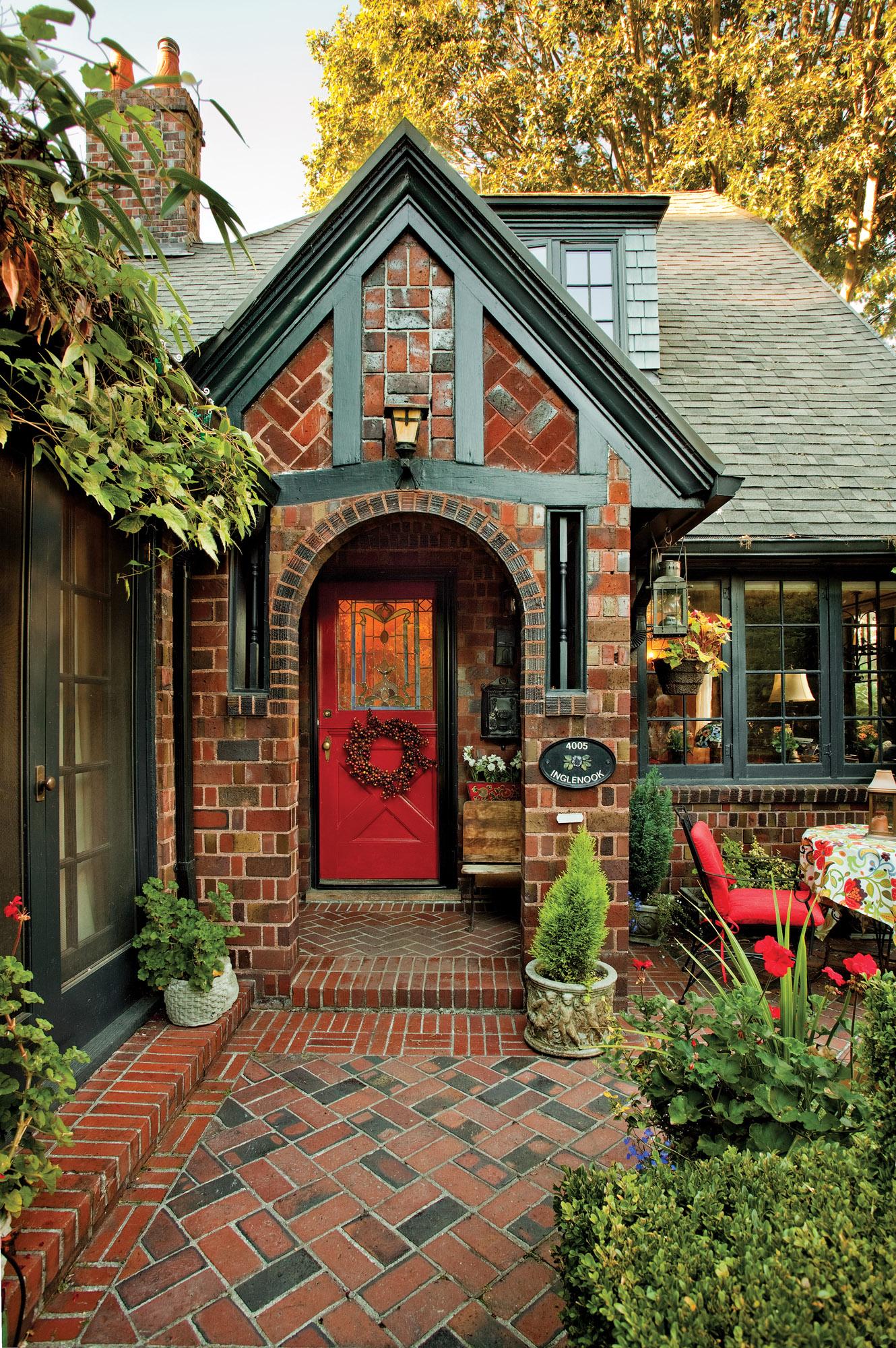1920s Tudor home, red door, brick home with red door