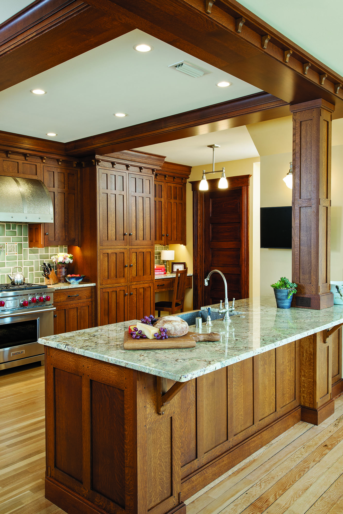 Quarter-sawn white oak and green ceramic tiles give an authentic Craftsman look to this Wisconsin kitchen.