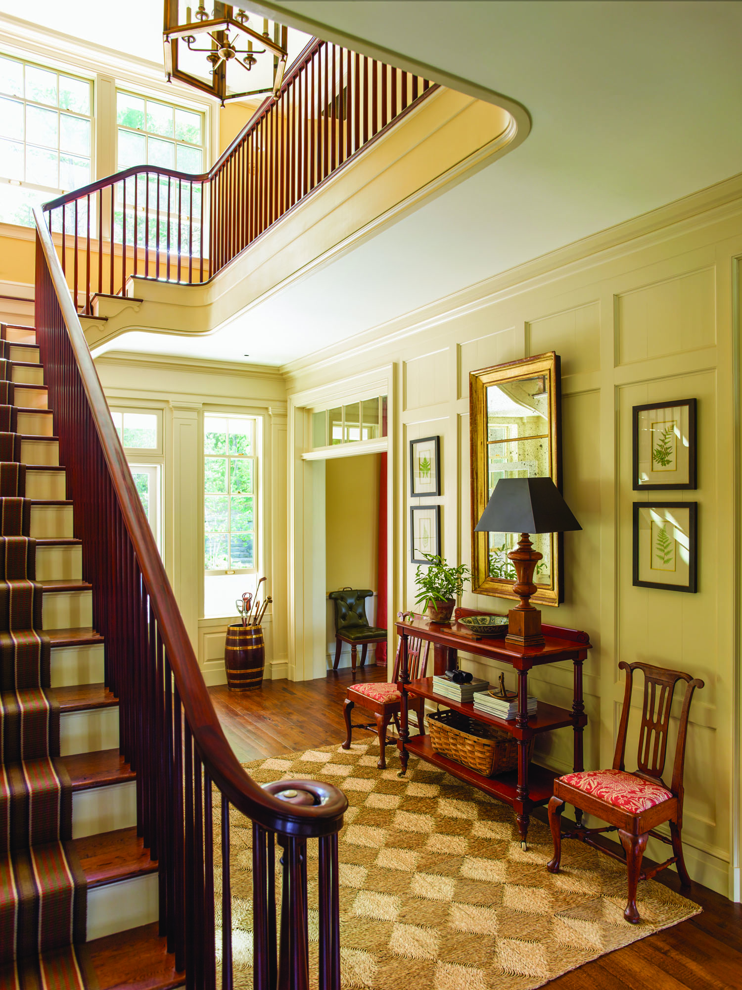 The entry hall encloses the house's main staircase and opens into its central public room, the great room