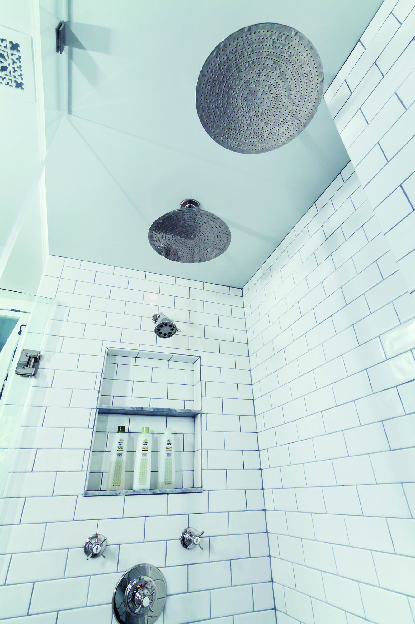 "The couple revel in taking showers under the 12"" showerheads they bought when renovation was still years in the future. At the time, however, the lack of an in-between size sparked an intense exchange between the married authors."