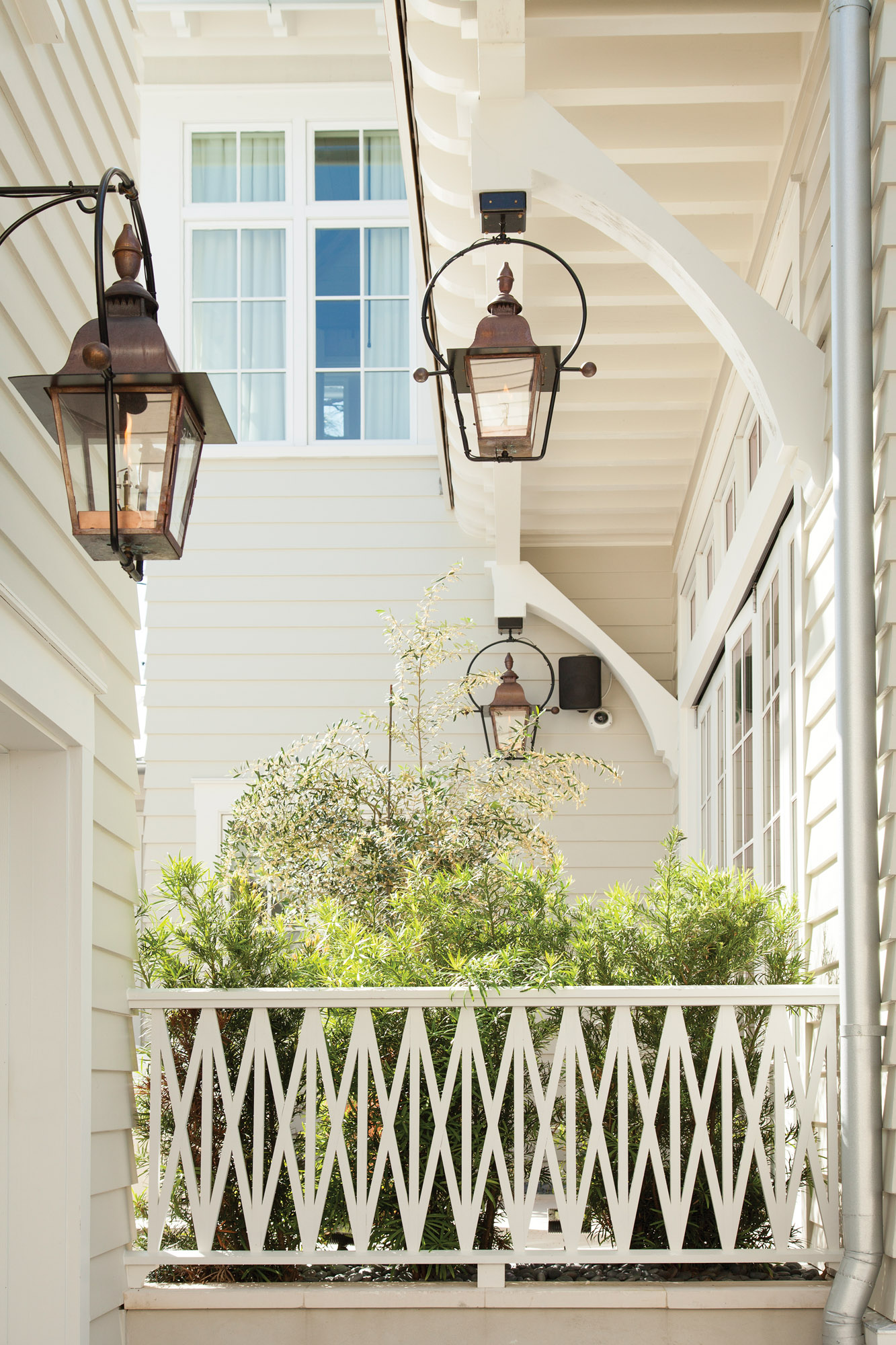 Exterior details are simple: period lighting and neutral colors.