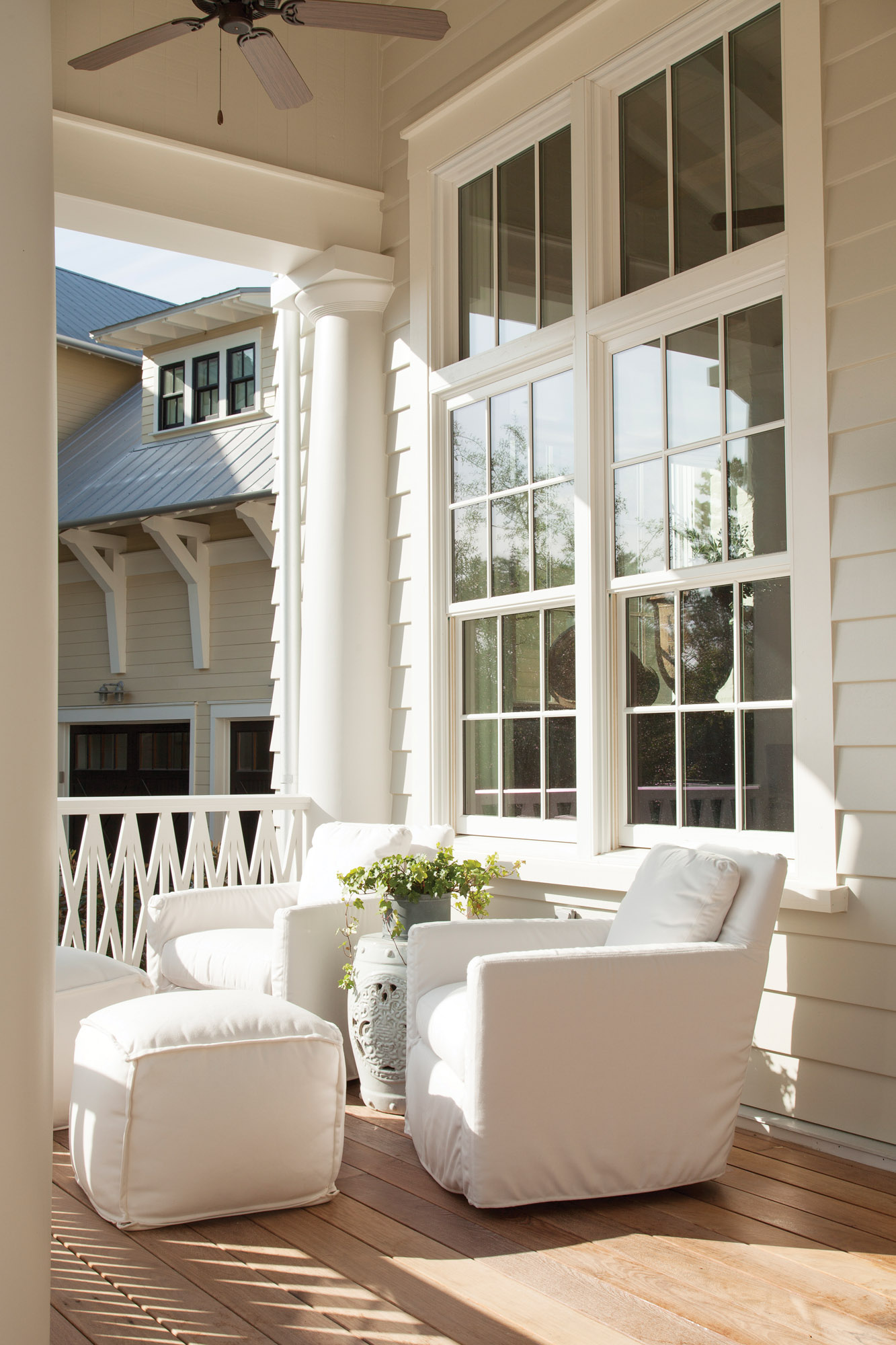 Large windows with transoms above allow the Florida sunlight to pour  inside. Half of the front porch is open.