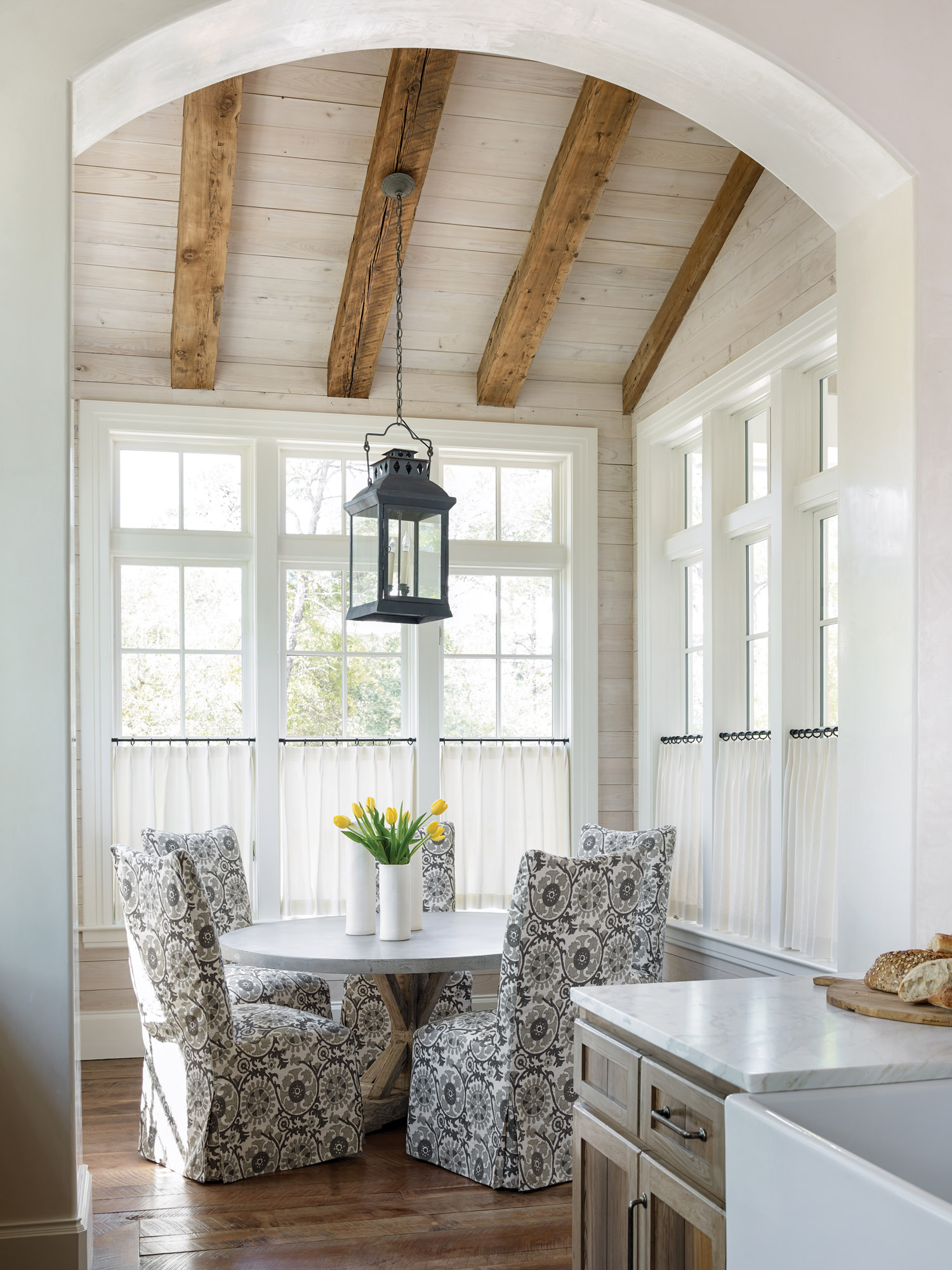 Ample natural light and an abundance of reclaimed wood keep the the space feeling warm and bright.