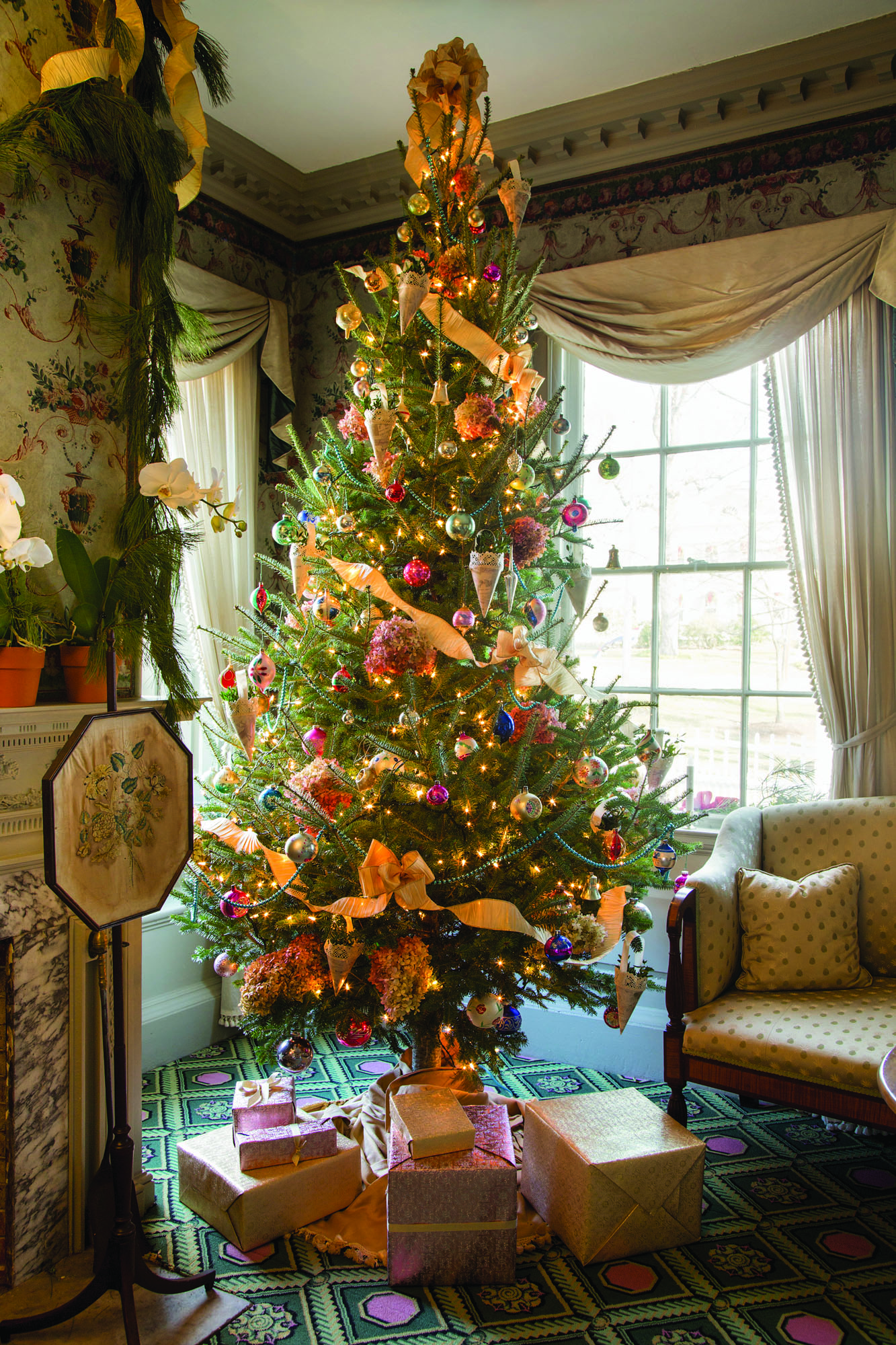 The tree in the formal Phelps parlor is decorated as it might have been in the late 19th century, set with ornaments belonging to Harrison's grandmother-in-law. True Victorian gems on the tree include the glass beads. The Christmas cones were made from heavy replica Victorian wrapping paper, cotton lace, and satin ribbon.