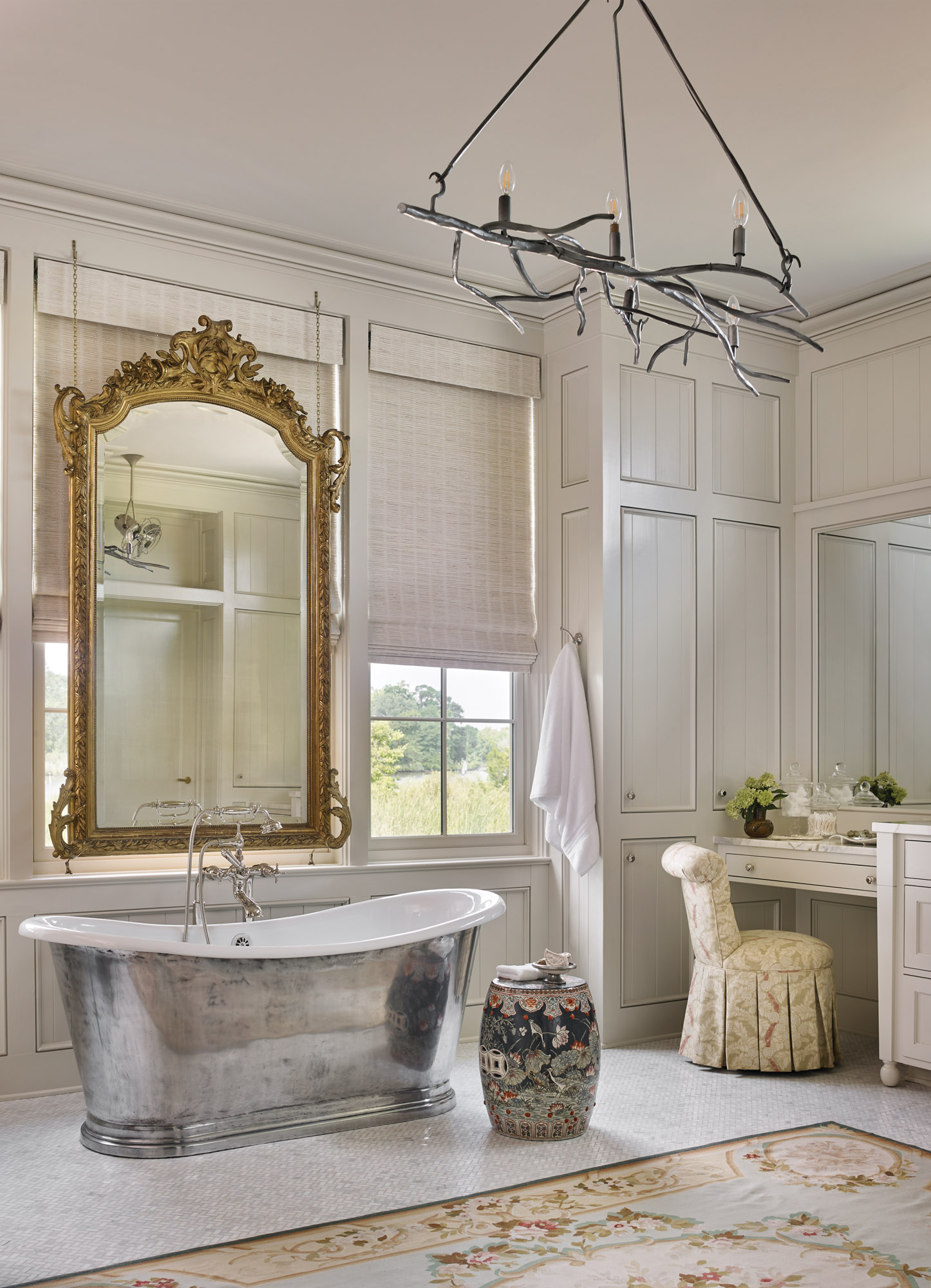 Craftsmanship is evident even in the master bath. Suspended on chains in front of a window overlooking the bayou, an heirloom mirror lends privacy.
