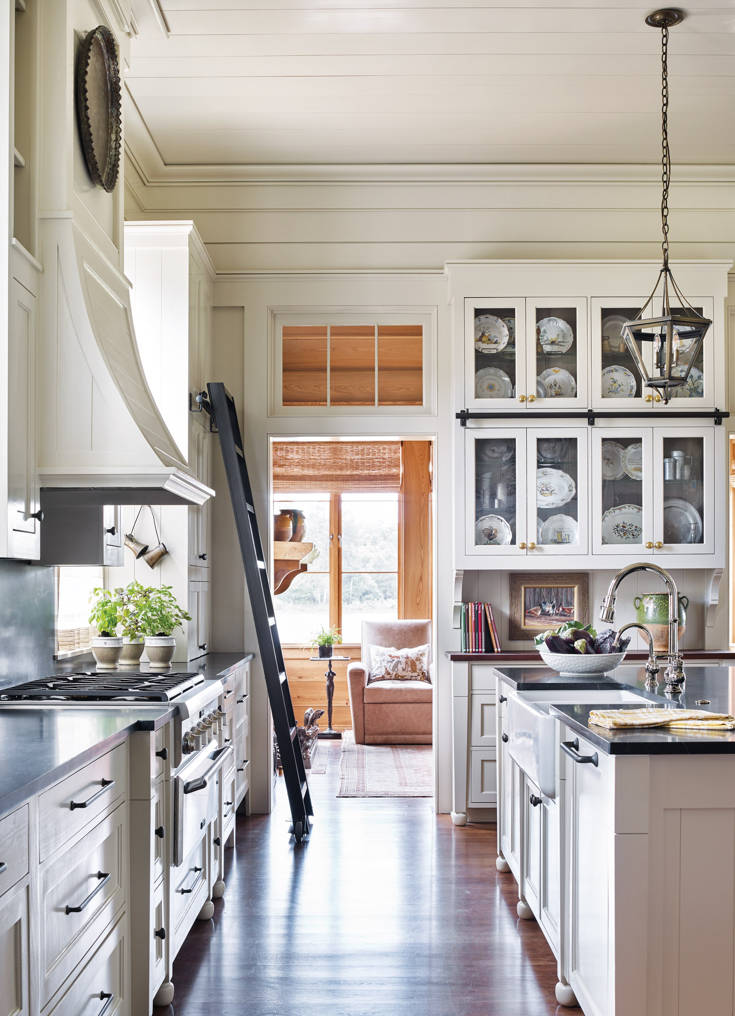 The main kitchen has cabinets reminiscent of a butler's pantry, with closed and display storage that stacks almost to the ceiling. A separate pantry can be opened for extra prep space.