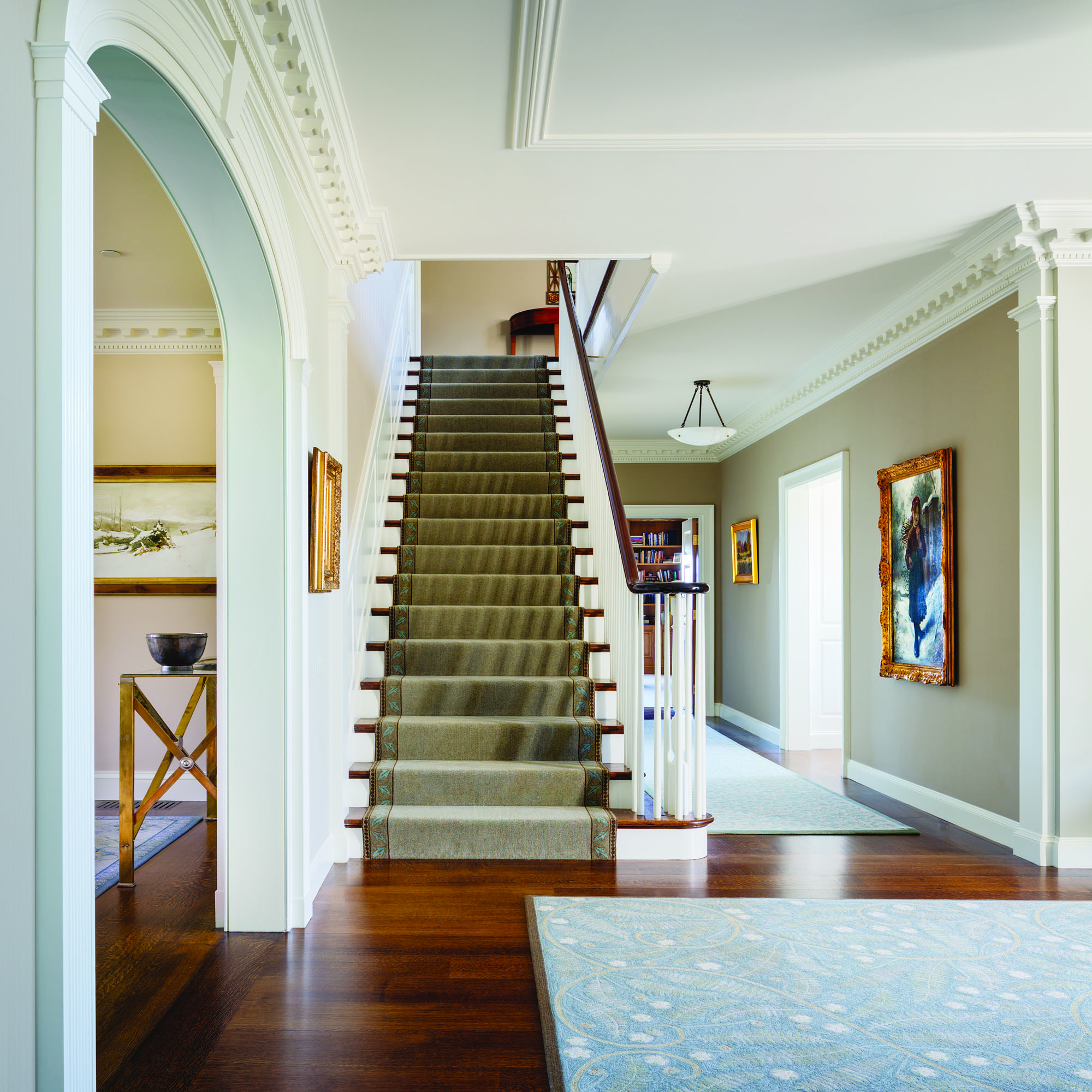 The interior stair hall is classically designed.