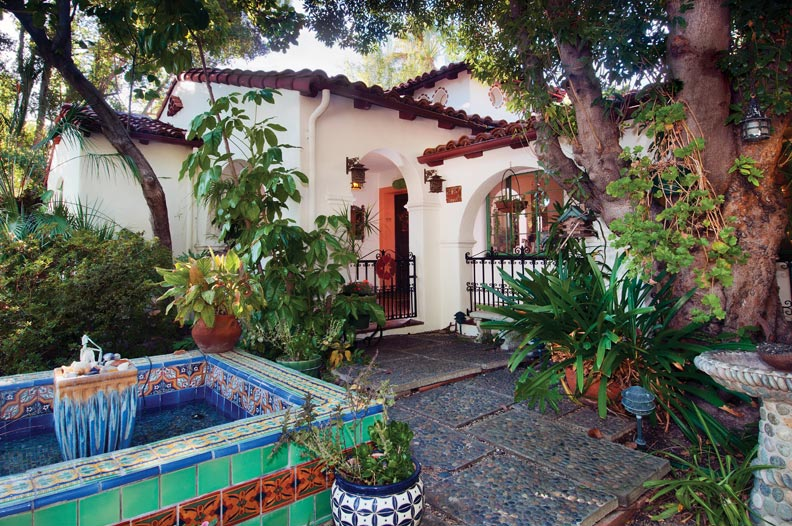 The homeowner designed the traditional Spanish fountain in the courtyard in memory of her younger brother, who was a surfer. Tiles are both antique and new.