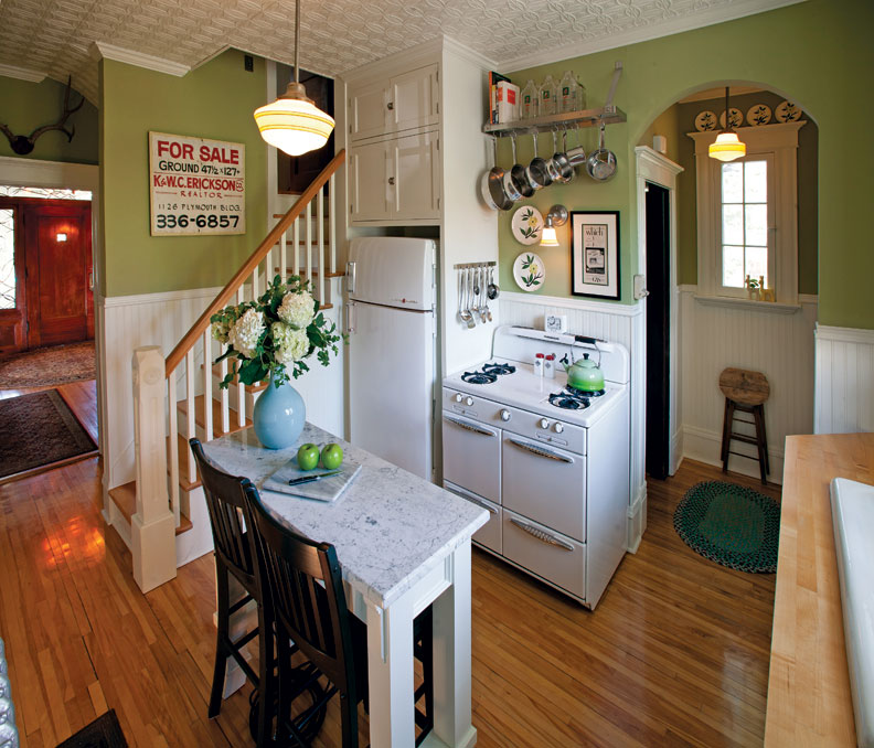 With the new configuration, Ryan and Montana were able to fit a small island into the kitchen. The sign on the staircase, which they found in the garage, is from the previous owner's real-estate business.