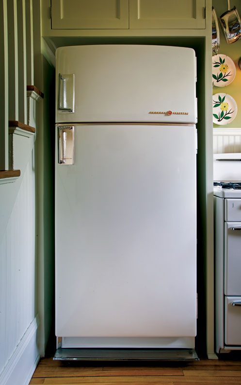 The refrigerator nook was designed with enough space to fit a modern fridge.