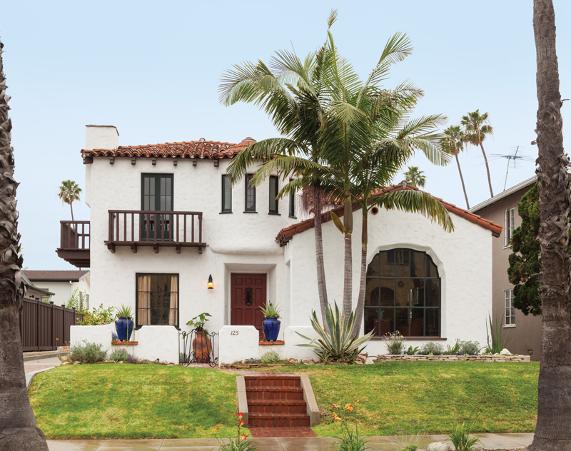The 1928 Spanish Revival home was remarkably intact, with its original red tiled roof, balconies, tower, and arched casement windows.