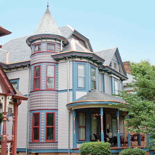 The 1902 Indiana Victorian had significant rot. Dedicated owners have renewed the porch and given the house a lively paint scheme.