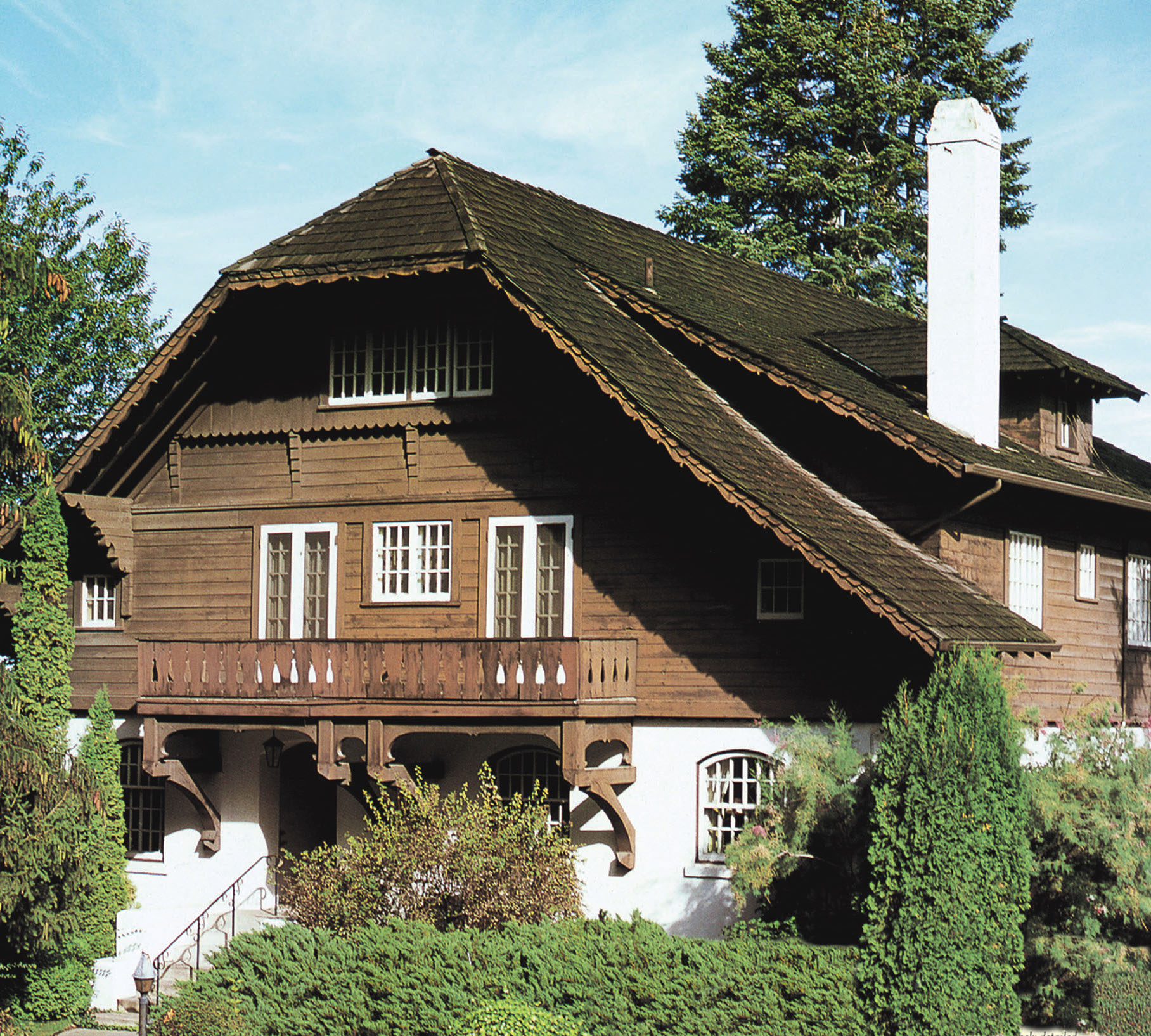 A 1910 house in Spokane is a medieval take on the Swiss Chalet with its clipped gable and huge brackets under the balcony.