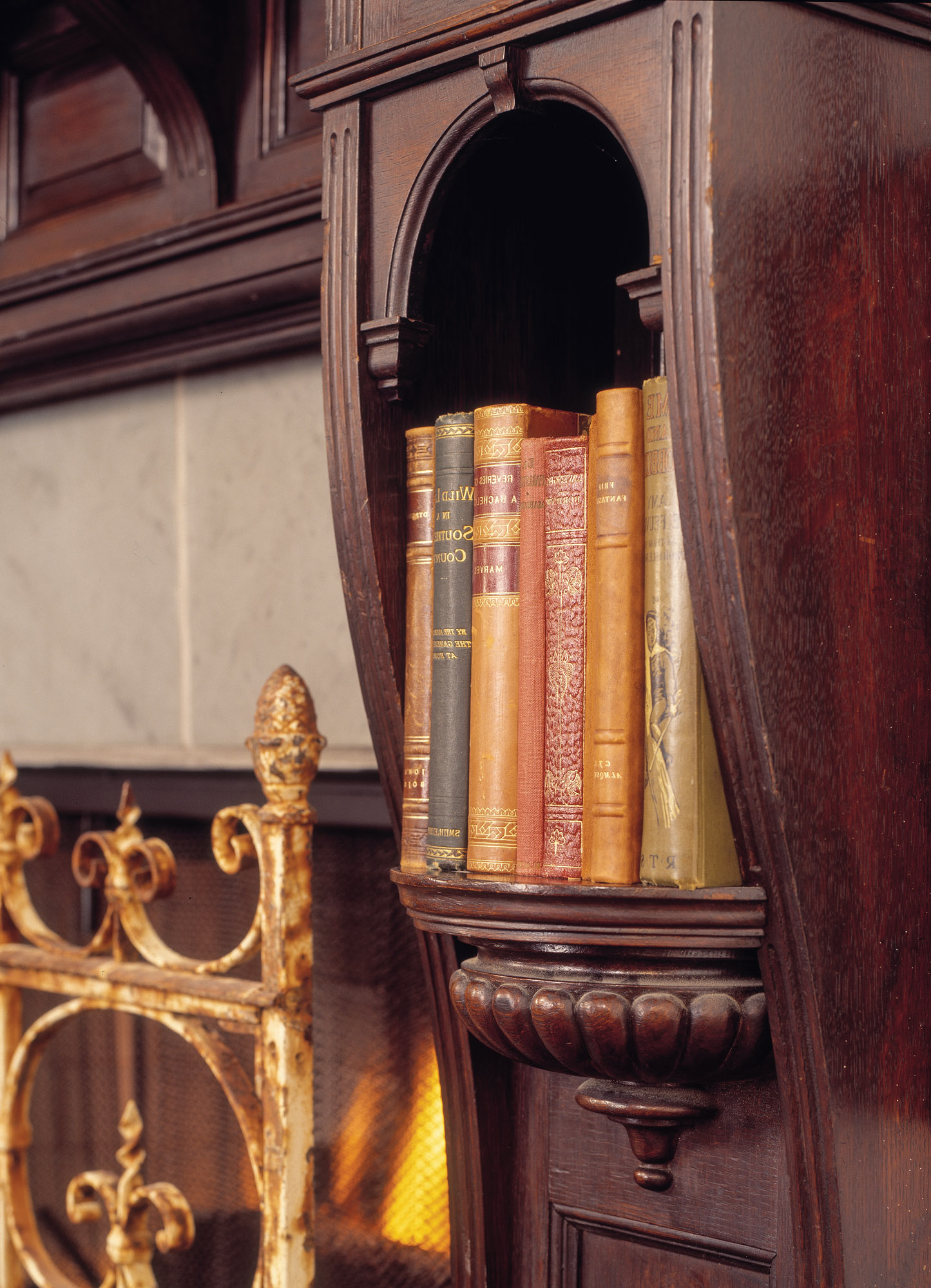 mantel's carving and book niches