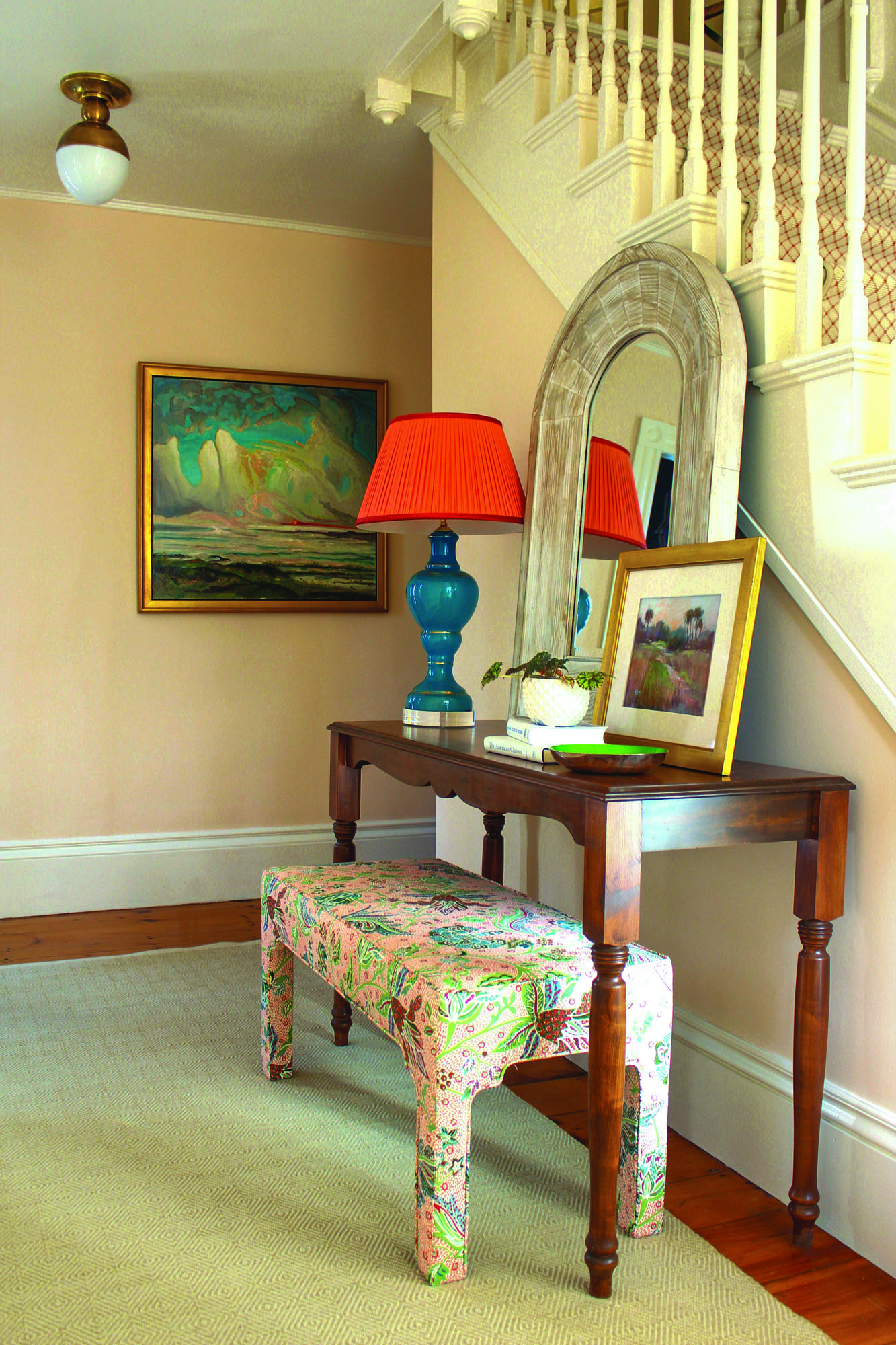 The new paint color, keyed to the coral in a painting bought at an estate auction, made all the difference in the foyer.