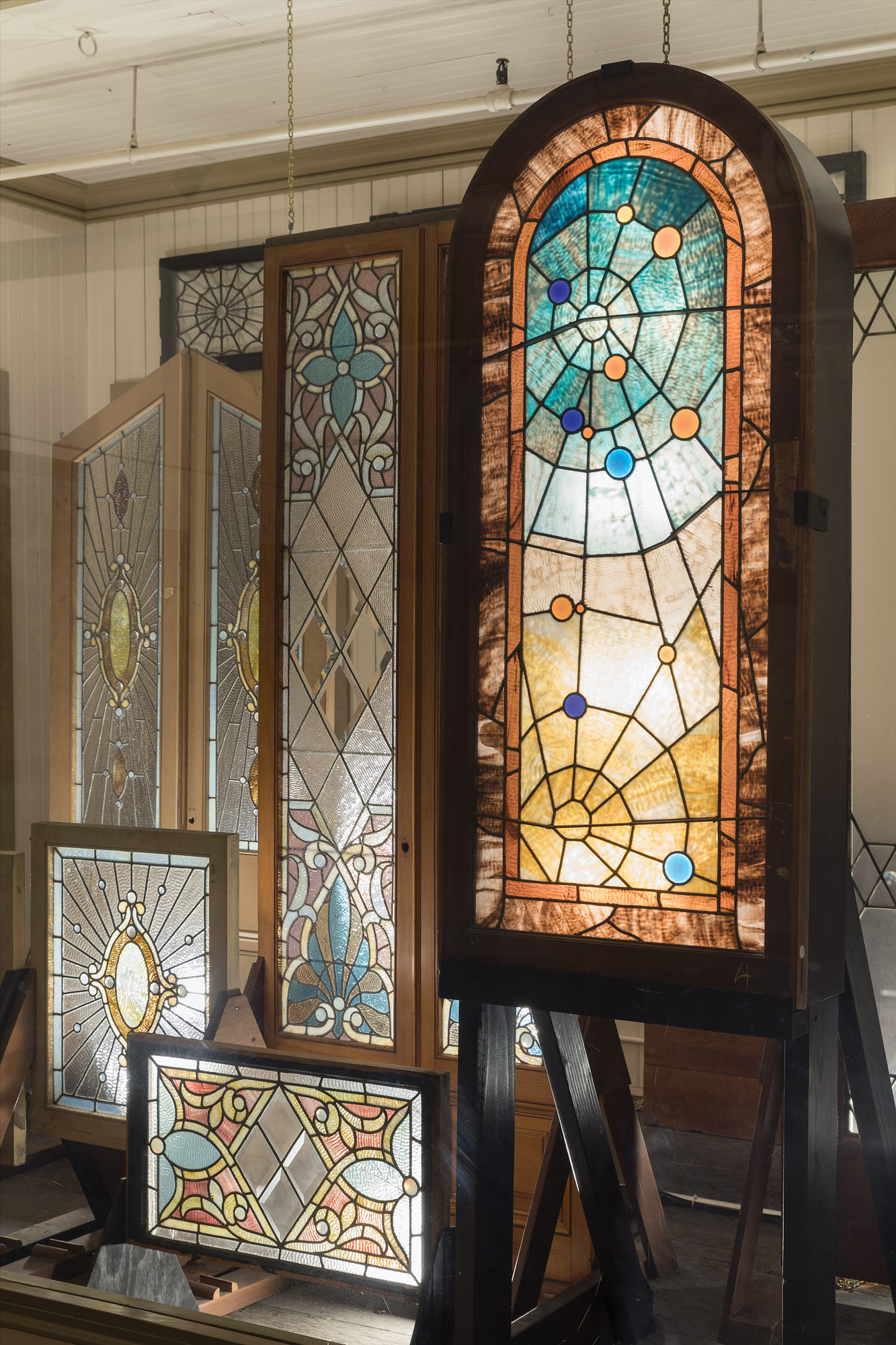 Many stained-glass windows were never installed, and today are displayed in Sarah's storage room.