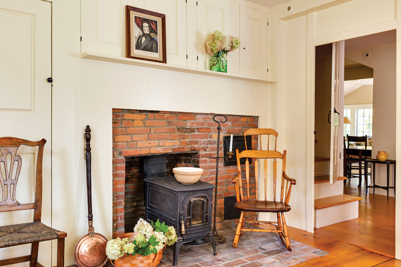 What's now the parlor retains key period details, like the keeping-room fireplace and ovens with built-in cabinets above. Wide-plank floors are original.