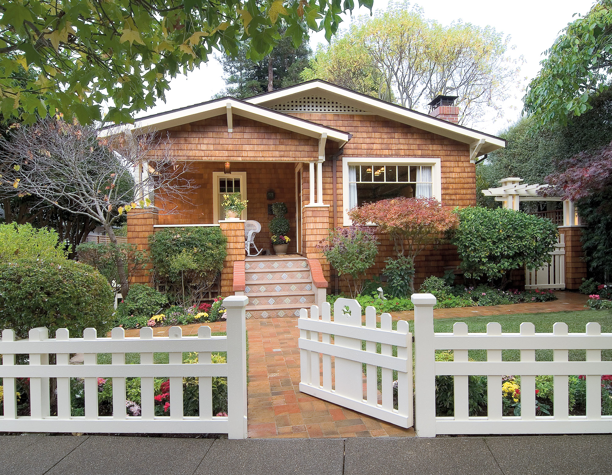 bungalow with white fence