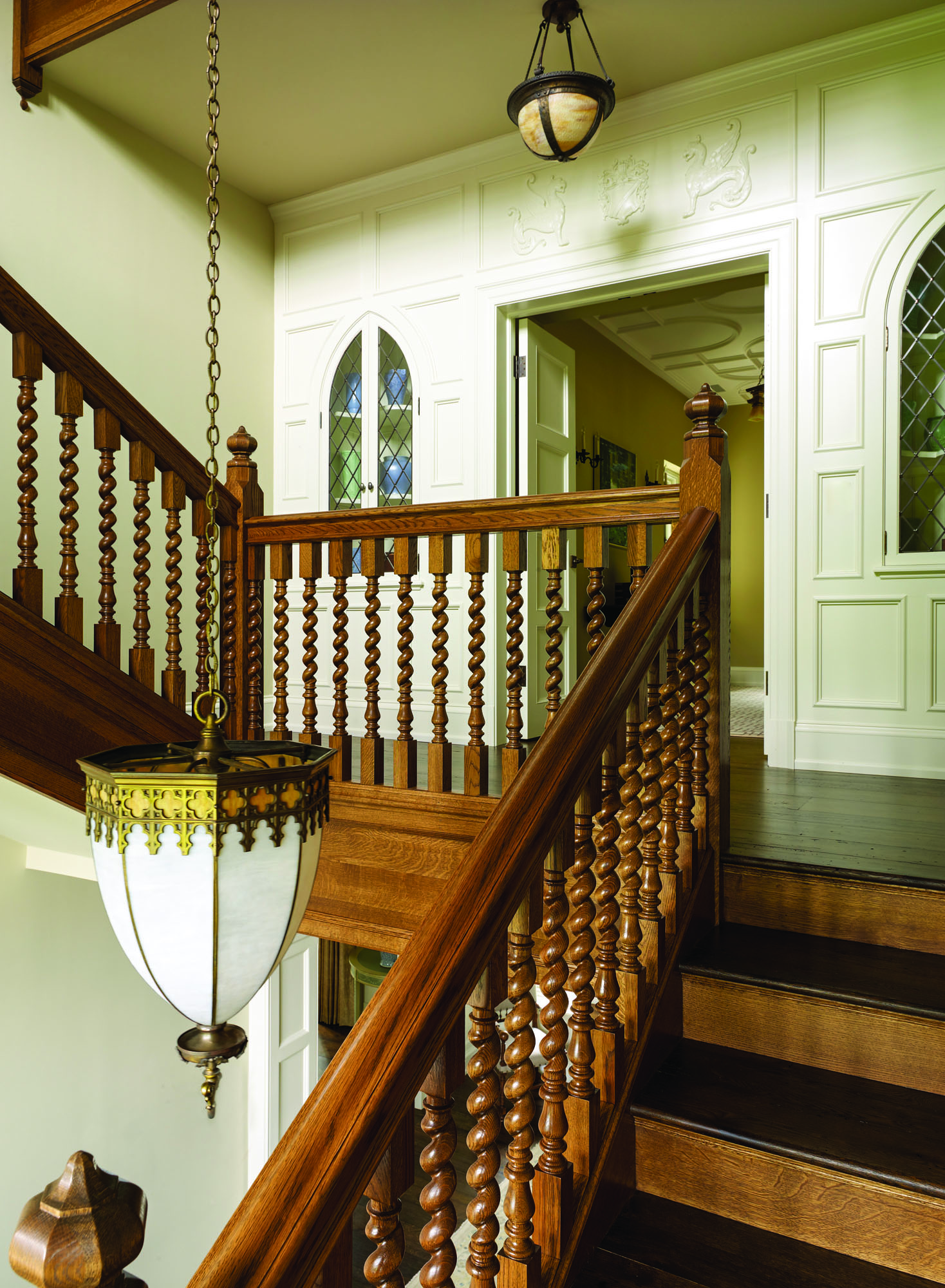 The oak stair was inspired by English precedent.