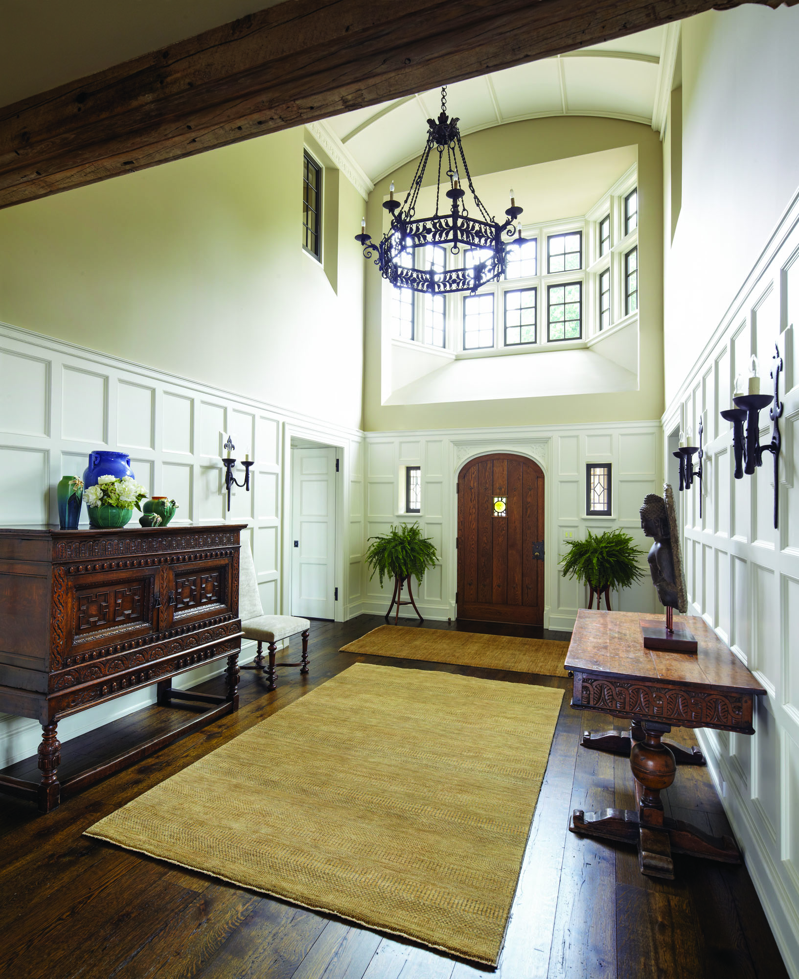 Entry hall features a high wood wainscot.