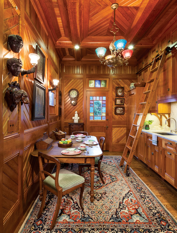 galley kitchen, cherry paneling
