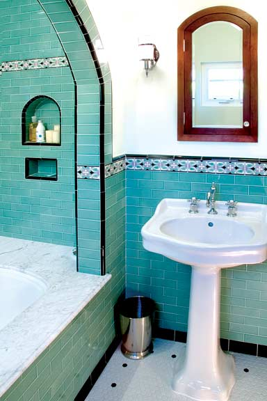 """In the master bathroom, the whirlpool tub is topped with a Carrara marble surround. """"Even though it's a modern idea, we tried to be sensitive by keeping it simple and using historic materials,"""" says John."""