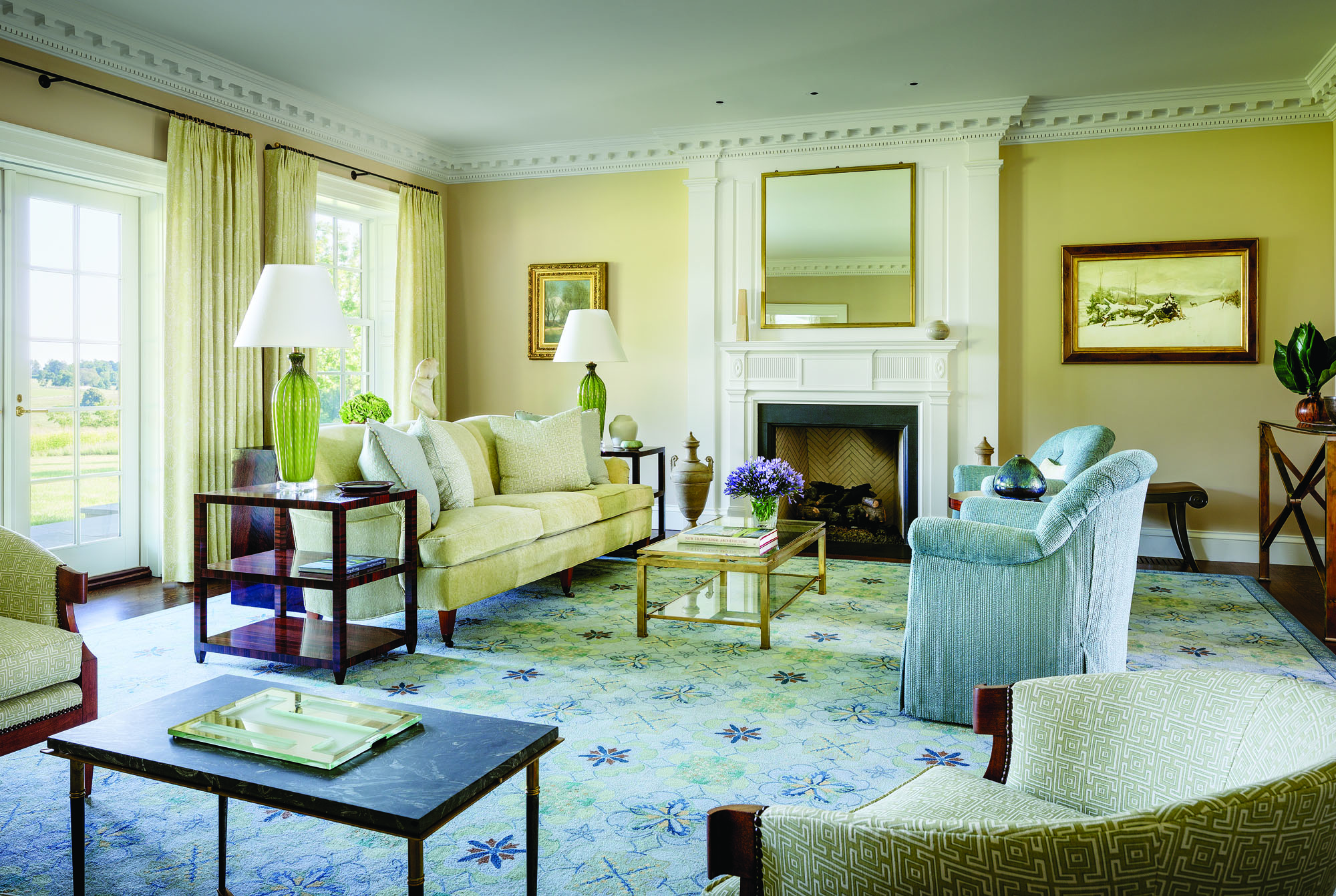 The living room is designed in soft blues and mellow yellows.