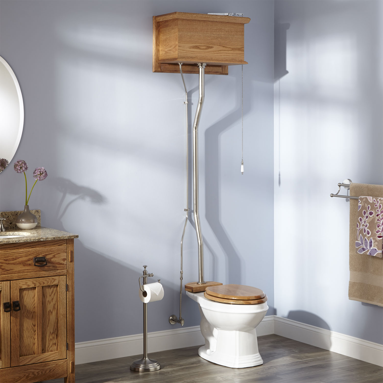 Elongated high tank pull-chain toilet in brushed nickel