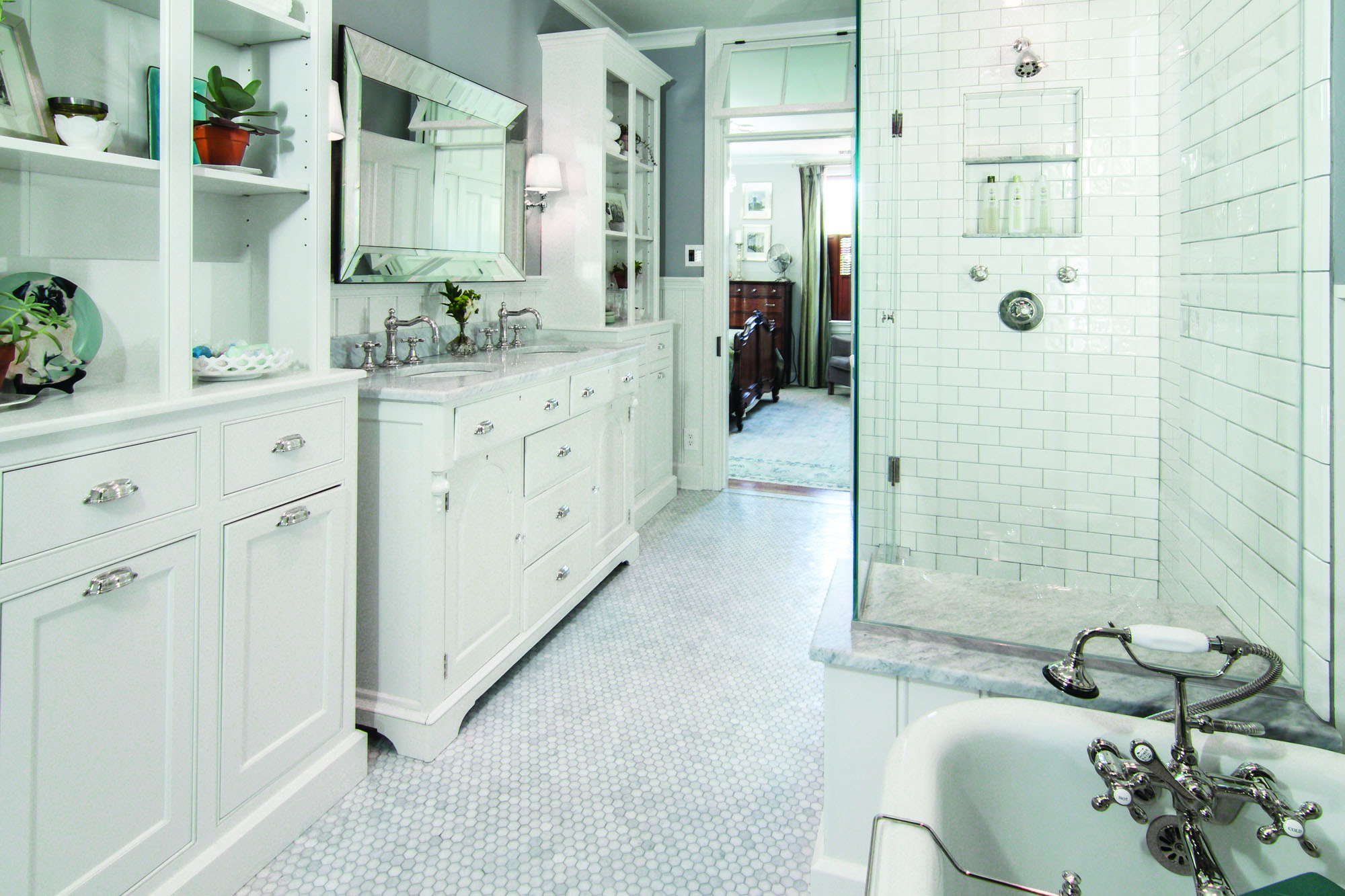 Alex  designed and built the storage cabinets on either side of the vanity, right down to pull-out laundry bins.