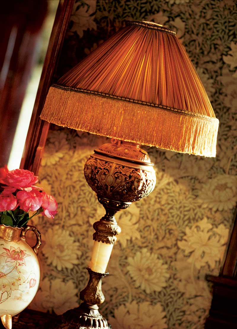 Atop a lamp base ca. 1875, this simple pleated and fringed style is taken directly from a 1905 photo.