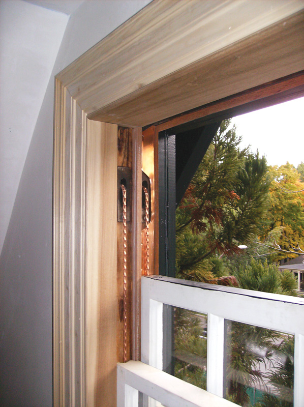 Hardy spring bronze weather stripping helps seal air leaks around windows.