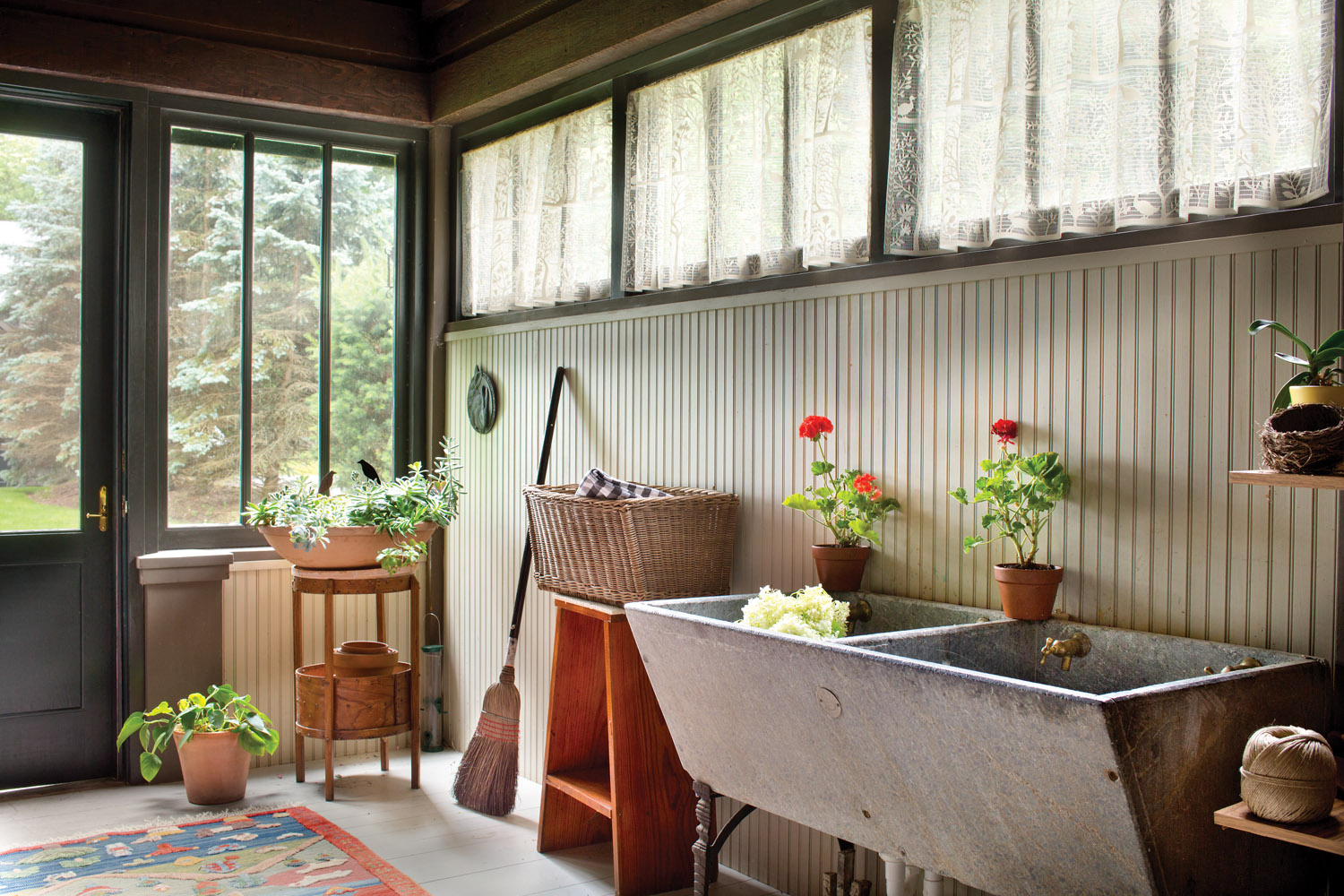 What had been a screened porch is now an enclosed mudroom, with a stone laundry sink perfect for gardening tasks.
