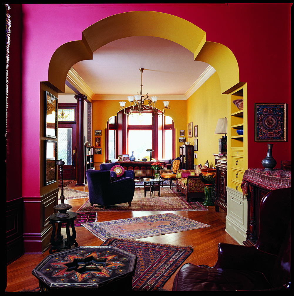 Newly imagined Moorish arches between parlors set the tone.