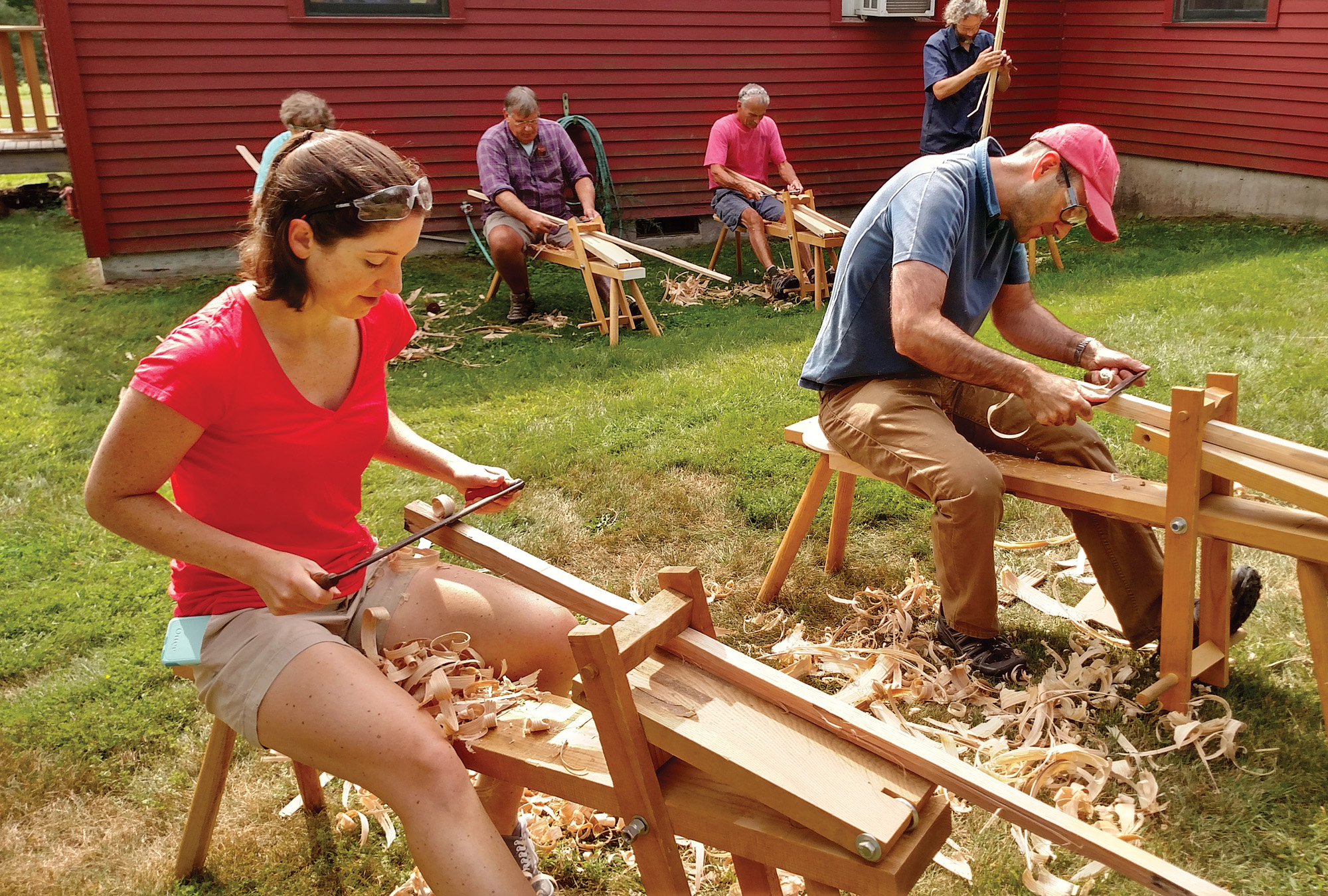 Students hand shave wood stock in the Windsor chair class.